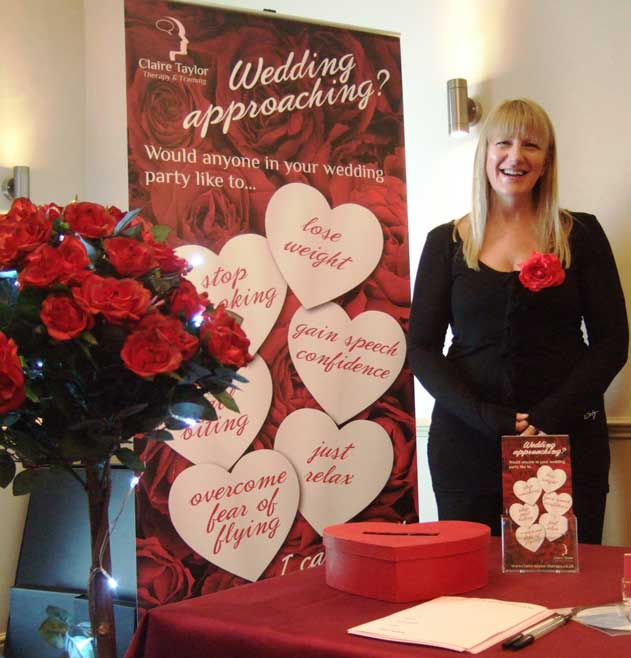 Claire Taylor with red rose display stand